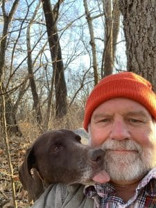 Selfie of J.R. Hooge with Dog licking his face